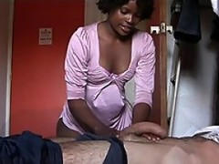 Today Antonio decides to try a different kind of sexual experience, going to an African house of ill fame for the first time.  He pays his money and then the madame lets him into the room, where curly haired black babe Sandy is waiting for him on the bed.  Her ass looks so God damn fine in her tight silken robe!  Antonio lies down on the bed and Sandy gives him a brief massage that soon leads to a hand job and blow job.  Antonio bends Sandy over on the bed and screws her from the back with no condom, pulling her panties roughly down around her knees while he bangs her.  He spurts right up Sandy's nose and two streams of semen consent dribbling out.