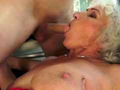 Norma with giant knockers is in sexual ecstasy with hard cocked guy